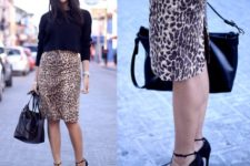 With black loose sweater, black high heels and tote