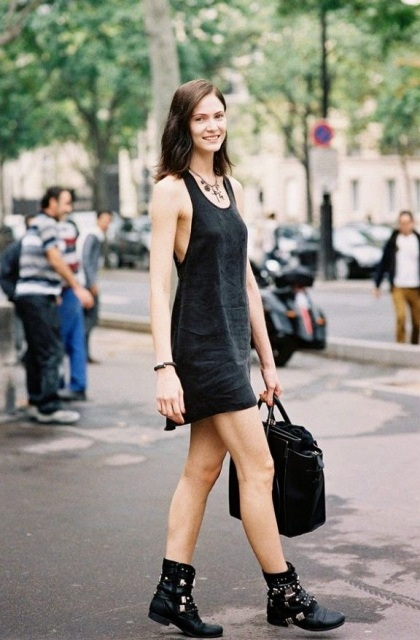 With black mini dress and black tote bag