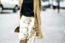 With black shirt, beige long cardigan and black shoes