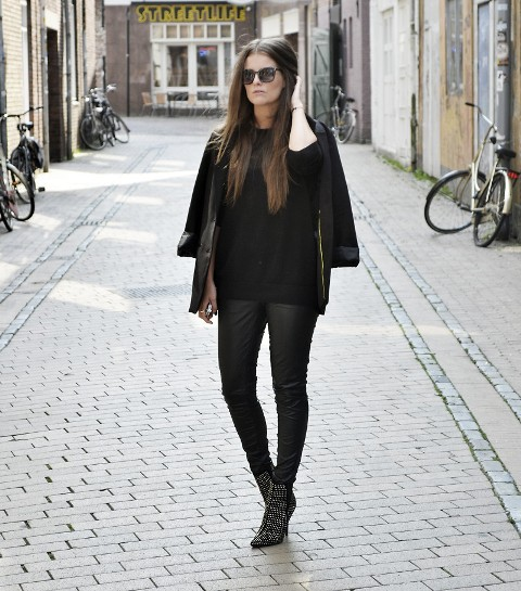 With black shirt, black jacket and skinny pants