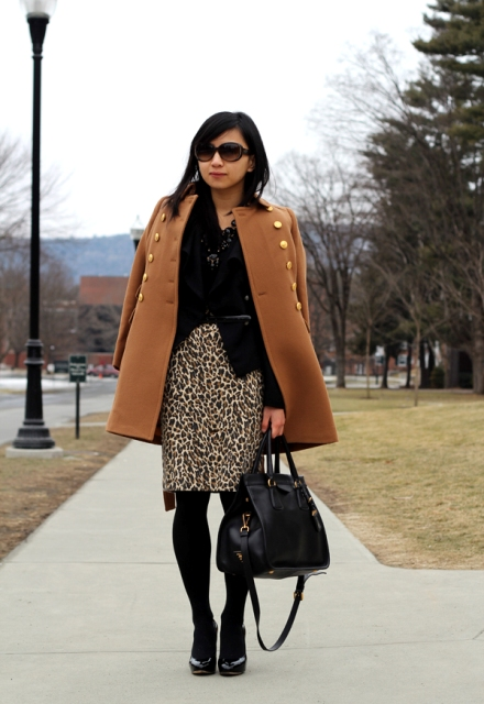 With black shirt, brown coat, bag, black tights and black shoes