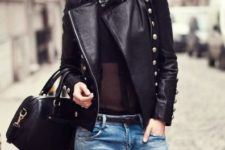 With black shirt, distressed jeans and black bag