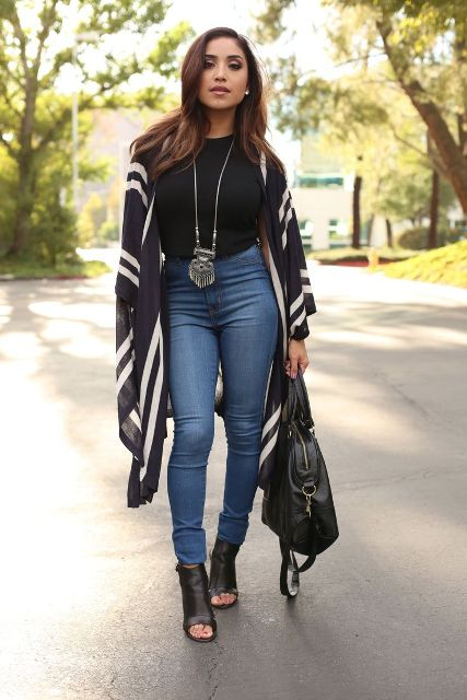 With black shirt, printed cardigan, black tote bag and cutout boots