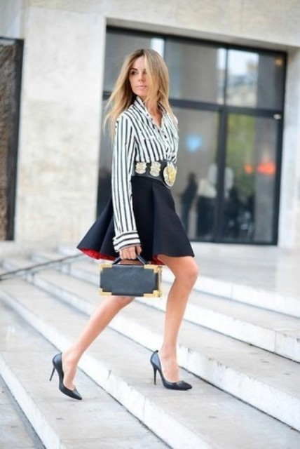 With black skater skirt, small bag and black pumps