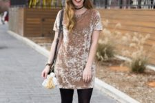 With black tights, crossbody bag and flat boots