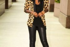 With black top, black leather pants and pumps