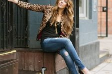With black top, distressed jeans and black high heels