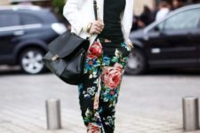 With black top, white blazer, black bag and floral pants