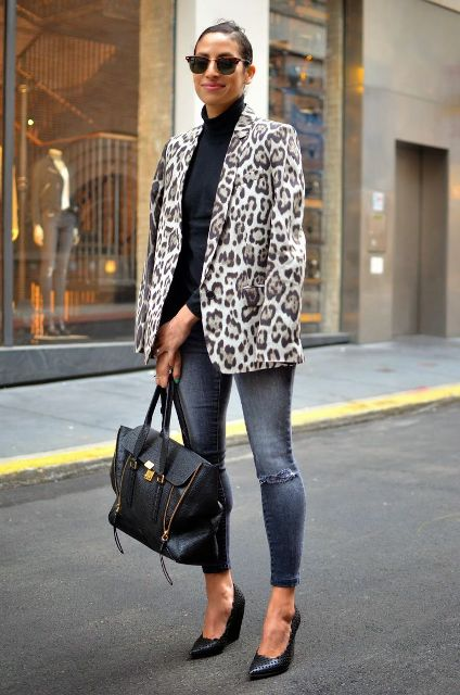 With black turtleneck, skinny jeans, black pumps and black tote