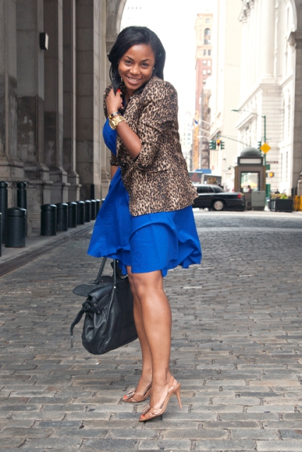 With blue dress, beige shoes and bag
