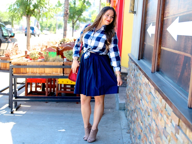 With blue skirt, red bag and cutout boots