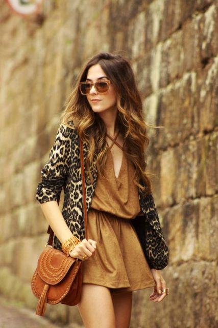 With camel dress and brown bag