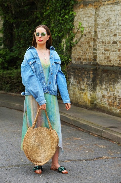 With colorful maxi dress, rounded bag and flat sandals