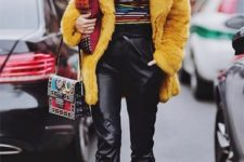 With colorful shirt, yellow fur coat, printed bag and lace up boots