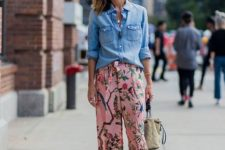 With denim shirt, sandals and beige bag