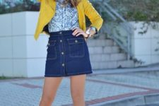 With denim skirt, yellow jacket and black pumps