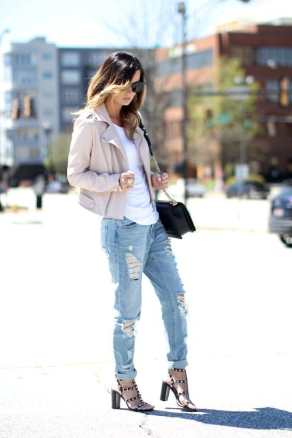 With distressed cuffed jeans, beige jacket, white shirt and black bag