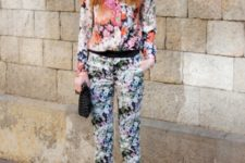 With floral pants, black clutch and black high heels