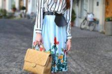 With floral skirt, black belt, beige bag and black shoes