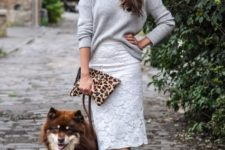 With gray loose sweater, leopard clutch and flats