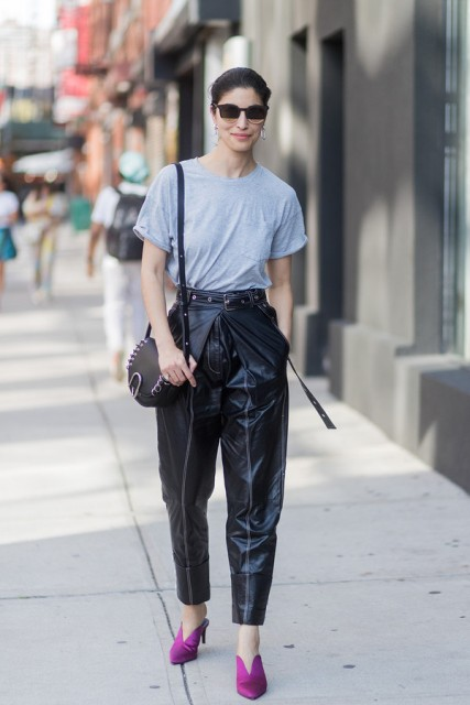 With gray loose t-shirt, black bag and purple mules