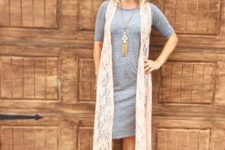 With gray midi dress and cutout boots