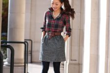 With gray mini skirt, brown belt, black shoes and black tights
