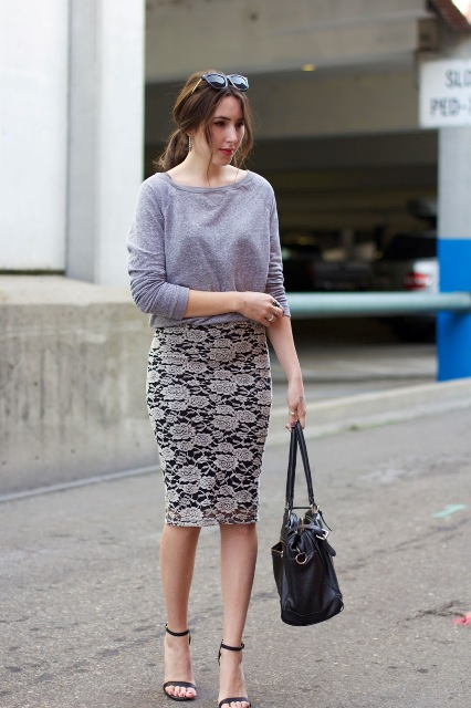 With gray shirt, black bag and ankle strap shoes