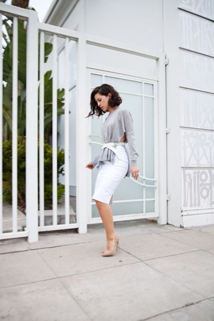 With gray shirt, white knee length skirt and beige pumps