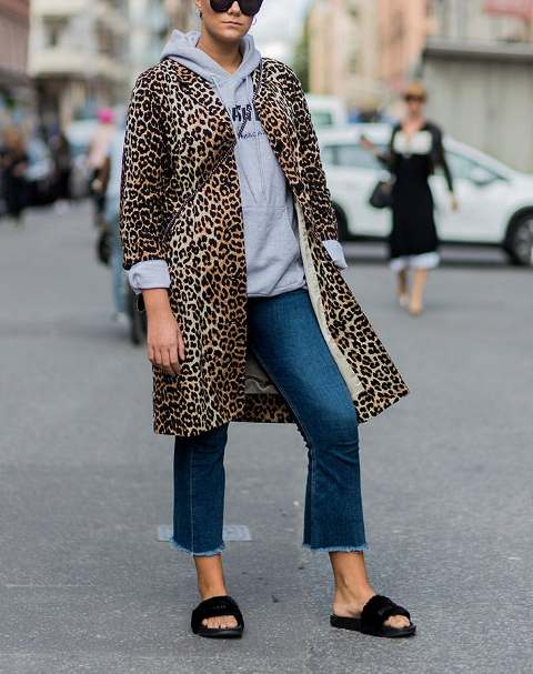 With gray sweatshirt, leopard coat and cropped jeans