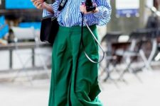 With green wide leg trousers, fur shoes and crossbody bag