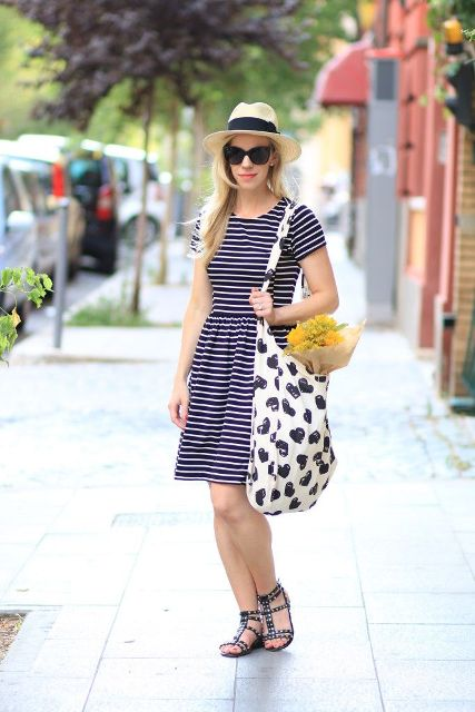 With hat, striped dress and printed tote bag