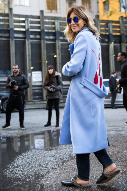 With jeans and light blue midi coat