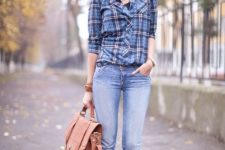 With jeans, brown bag and brown ankle boots
