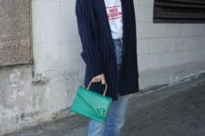 With labeled t-shirt, striped oversized blazer, green bag and brown shoes