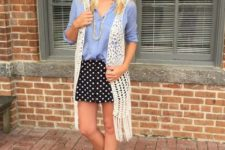 With light blue button down shirt, polka dot mini skirt and brown shoes