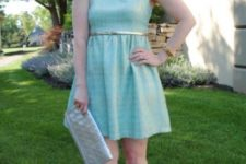 With light blue dress, clutch and metallic shoes