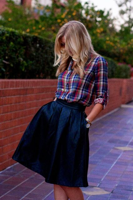 With navy blue A-line skirt