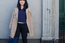 With navy blue blouse, black trousers, beige coat, black shoes and navy blue tote