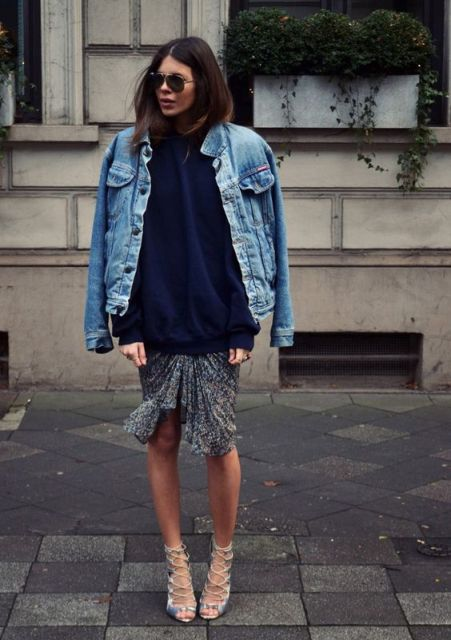 With navy blue loose sweater, printed skirt and lace up high heels