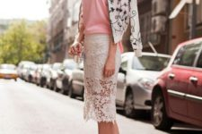 With pale pink shirt, floral bomber jacket and white ankle strap shoes