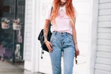 With pale pink shirt, platform shoes and backpack