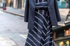 With patent leather boots and navy blue blazer