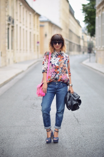 With pink bag, cuffed jeans, black jacket and platform shoes