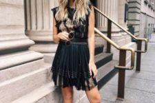 a sexy outfit with a pleated skirt and studded shoes