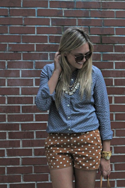 With polka dot shorts and necklace