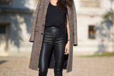 With printed coat, black shirt and black pumps