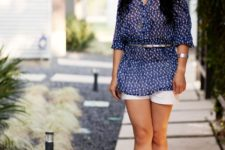 With printed loose blouse, white shorts and patent leather shoes