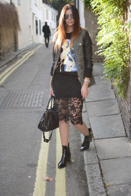 With printed shirt, jacket, black bag and black ankle boots