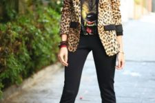 With printed t-shirt, flare trousers and metallic shoes